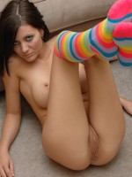 Kalee shows off her tight pink pussy in nothing but rainbow stockings
